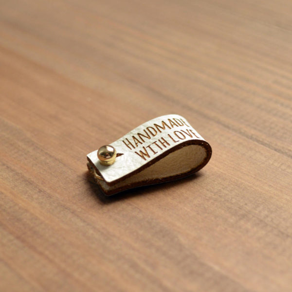 white leather rivet tags